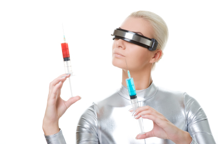 Futuristic woman holding 2 syringes filled with colored fluid