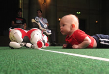 baby playing with robot